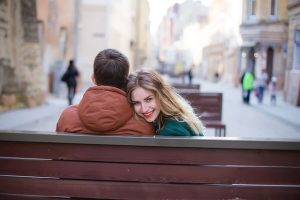 Dating couple sitting on a bench