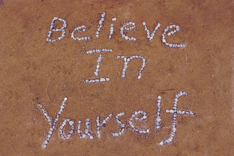 Believe in Yourself in sand