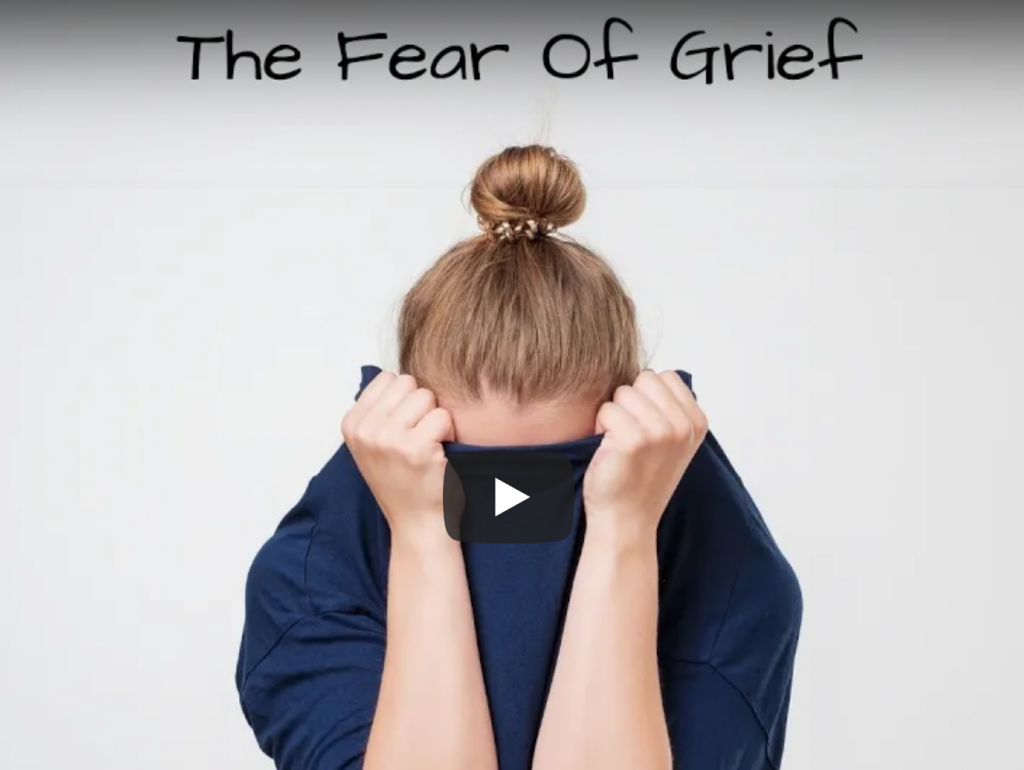 Fear of grief, woman with shirt over face