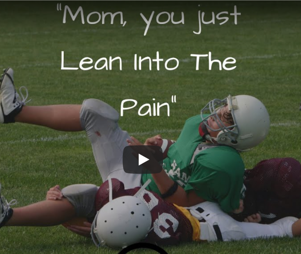 boys playing football on the ground, lean into the pain